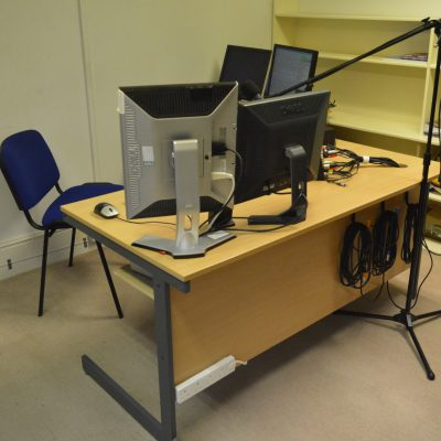 The back of the studio desk, with power outlets for laptops and phones, as well as hooks to keep our cables tidy when not in use.